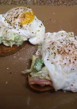 Imitation Crab Salad on Crostini topped with a poached Egg