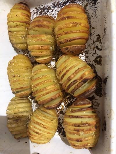 Hassleback rosemary and garlic new potatoes
