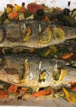 Roast seabass on a bed of roasted vegetables and samphire