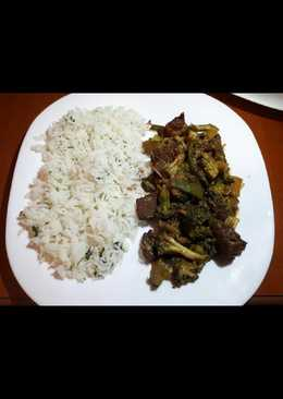 Meat with broccoli served with white rice