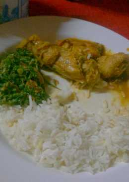 Stewed chicken served with rice and greens