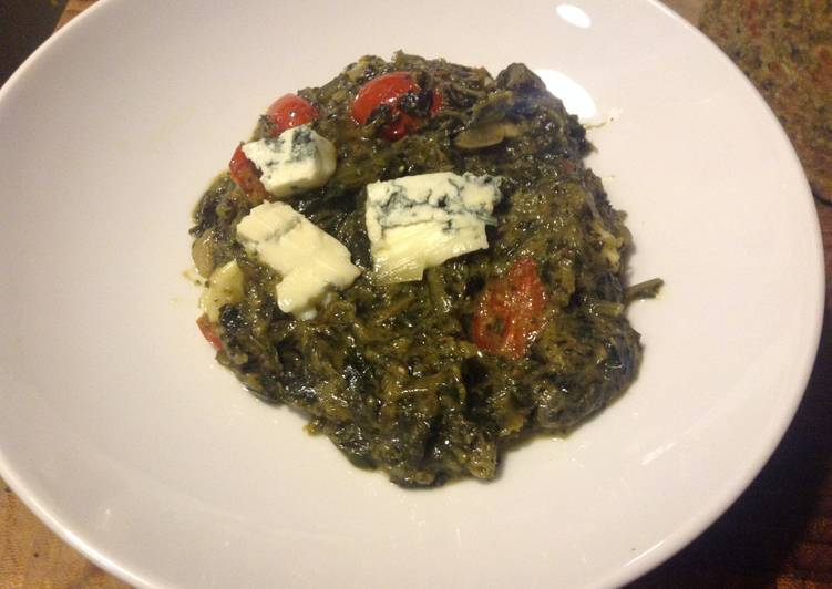 Dandelion Ka Saag. with grape tomatoes and blue cheese