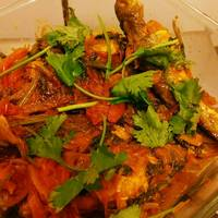 Dhaney tangra (tangra fish cooked with coriander powder)