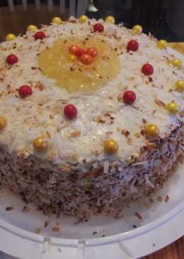 Pineapple filled toasted coconut yellow rum cake.