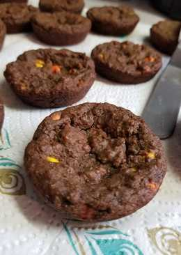 Chocolate Reeses pieces cookies in muffin tins
