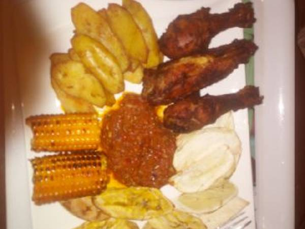 Fried plantain,Fried chicken,roasted corn with sauce