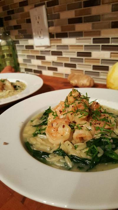 Butter poached shrimp with parmasan spinach orzo risotto