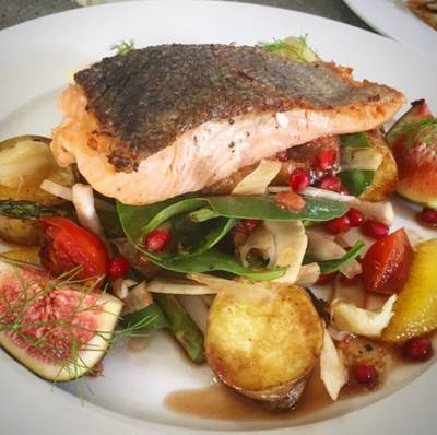Seared salmon on figs, roasted potatoes, fennel spinach and pomegranate dressing