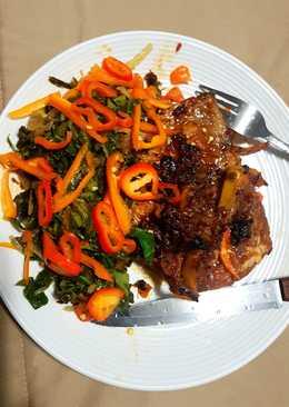Honeyed Pork chop on Kales bed