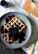 Vegan waffles with warm blueberry and maple syrup compote