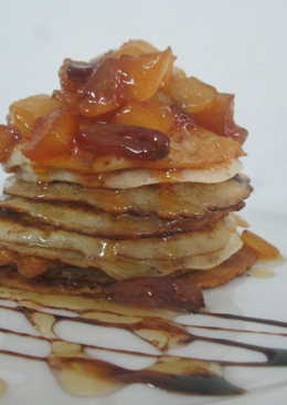 Wheat flour pancake with caramelized fruits and honey glaze