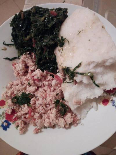 Fried eggs with greens and ugali