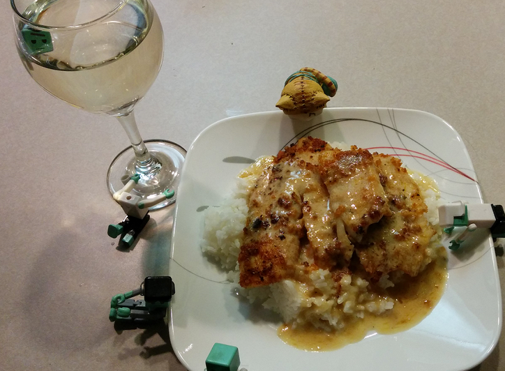 Pan Fried Fish With a Lemon Butter Sauce Over Rice