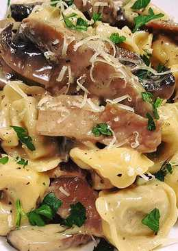 Veal tortellini with creamy mushroom, bacon sauce
