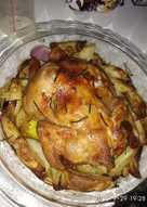 Roast chicken with potatoes,onion and garlic