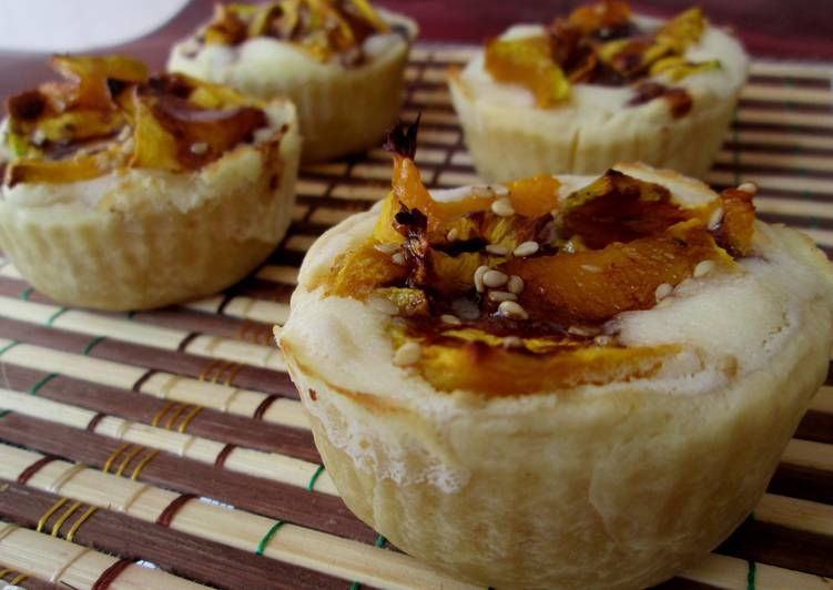 Roast pumpkin & cheese cups with chocolate-honey topping.