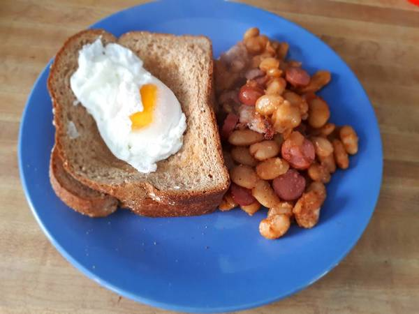 Poached Egg served with baked beans