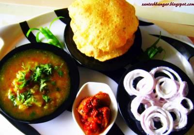 Kachori Alloo subji with curd onion rings