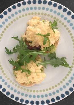 Scrambled egg and avocado on English muffin