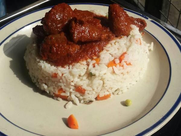 Veggie rice served with offals stew