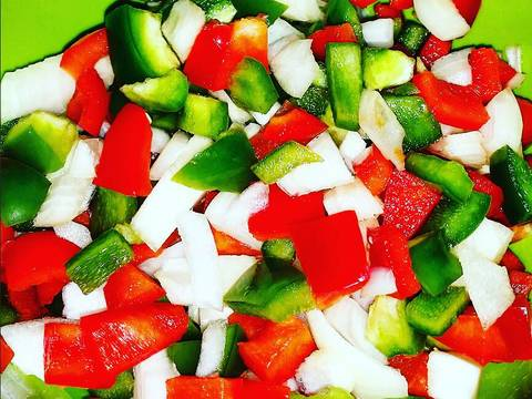 Start by dicing peppers and onion and combining; set aside.