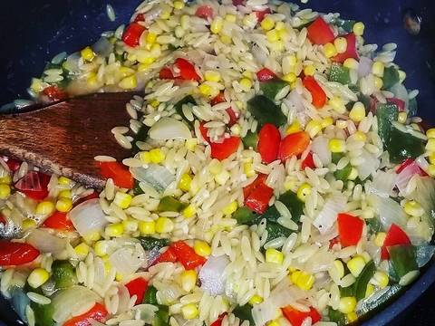 Add in orzo pasta and cook 1 minute.