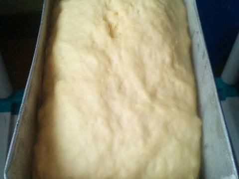 Line the bread tin. Put the loaf dough in and cover.