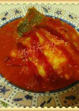 Bacalao con tomate y piquillos caramelizados