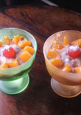 Mandarina y melón con yogurt de chocolate