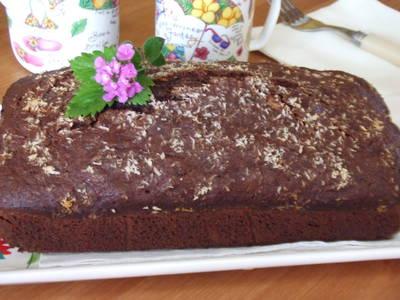 Cake de cacao con coco, naranja y nueces