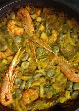 Arroz seco de marisco, alcachofas, habas y ajetes