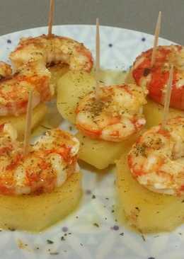 Pincho de patata confitada con langostino