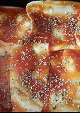 Falsa pizza con lomo de cerdo