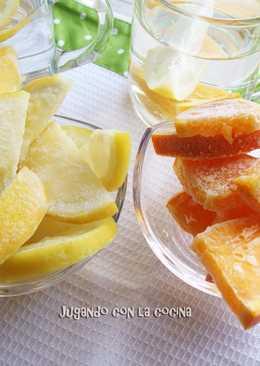 Naranja y limón congelados para enfriar bebidas sin aguarlas