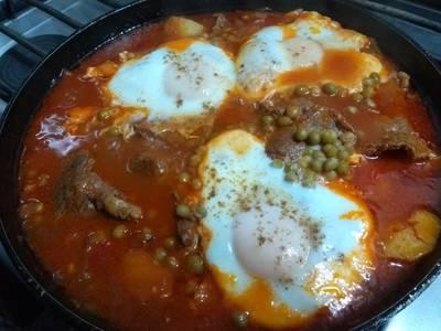 Bifes con salsa portuguesa