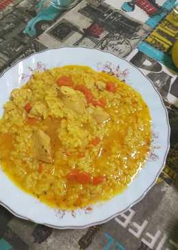 Arroz caldoso con pollo y zanahorias