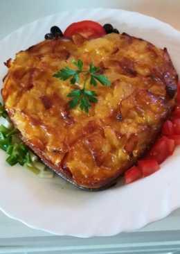 Tortilla de patatas, queso y jamón al horno