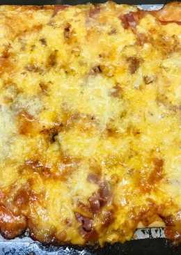 Pizza con masa de empanada
