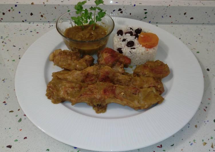 Conejo al ajillo y arroz salteado con frutos secos