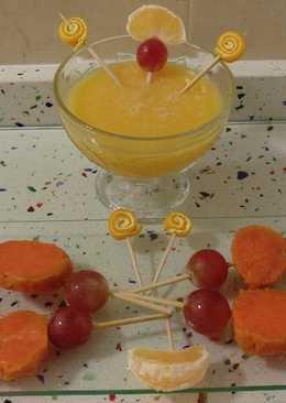 Smoothie de mandarinas con piruletas de boniato y uvas