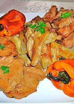 Lomo y costillas de cerdo en su jugocon berenjenas y pimientos