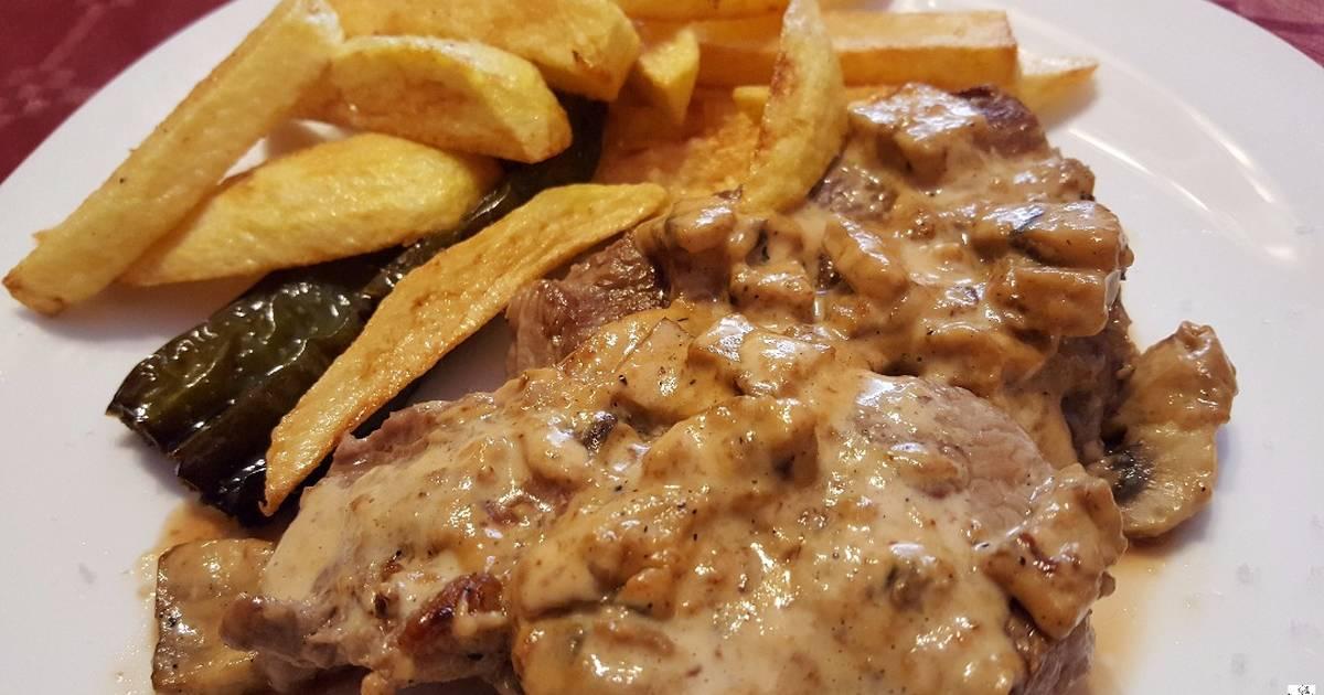Chuletas de cerdo con salsa de champi ones y soja receta for Como cocinar manos de cerdo