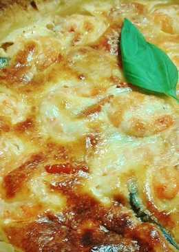 Berenjena a la parmesana con langostinos