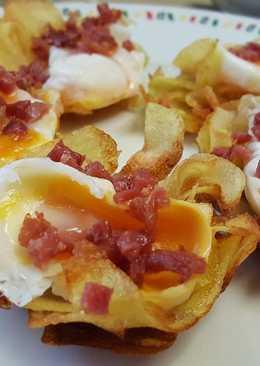 Tapa de patatas fritas huevo y jamón