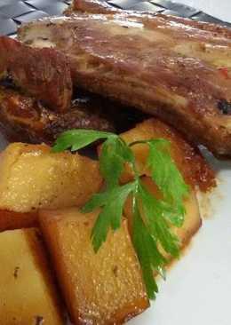 Costillas de cerdo con patatas al horno