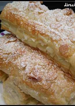 Cañas de hojaldre rellenas de crema pastelera