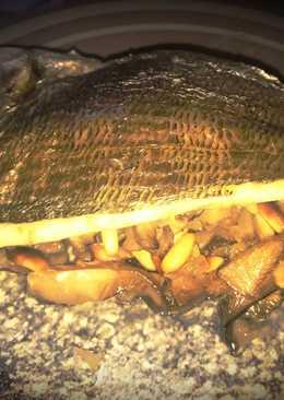 Lomo de Dorada al horno sobre cama de setas y piñones
