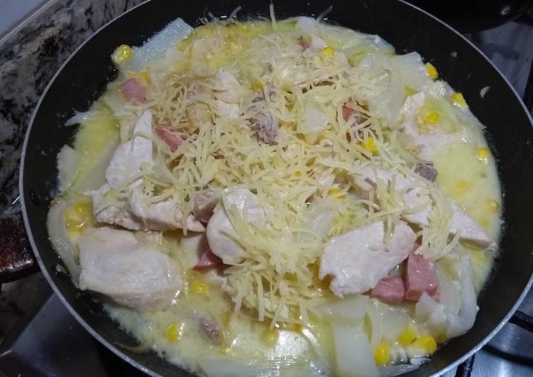 Pollo con queso parmesano y queso crema