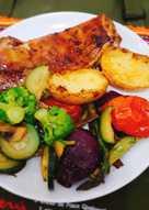 Costilla de cordero con verduras al horno
