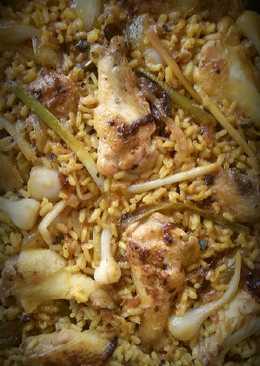 Arroz con pollo de corral y ajos tiernos